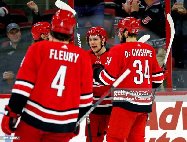 The Carolina Hurricanes' Jeff Skinner celebrates his goal with Haydn Fleury and Phillip Di Giuseppe during the first period against the Arizona...