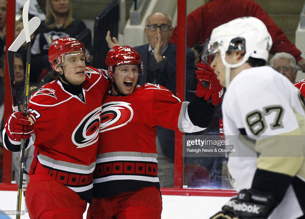 The Carolina Hurricanes' Jiri Tlusty (19) celebrates his first goal with teammate Alexander Semin (28) while the Pittsburgh Penguins' Sidney Crosby (87) skates away during the second period at the PNC Arena in Raleigh, North Carolina, on Thursday, February 28, 2013.