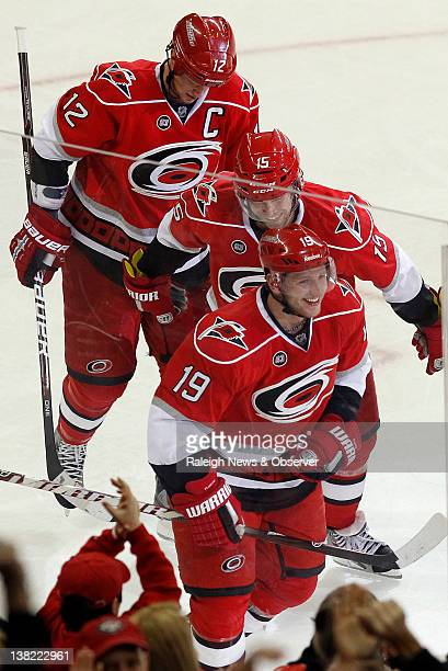 The Carolina Hurricanes' Jiri Tlusty clebrates with Tuomo Ruutu and Eric Staal after he scored during the second period against the Los Angeles Kings...