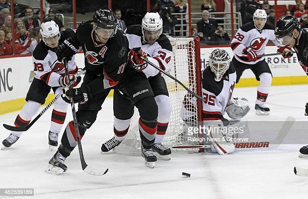 The Carolina Hurricanes' Jordan Staal and Eric Staal work against the New Jersey Devils' Steve Bernier Jon Merrill Cory Schneider and Anton...
