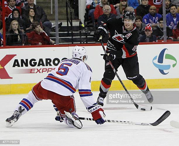 The Carolina Hurricanes' Jordan Staal shoots for a goal past New York Rangers defenseman Dan Girardi in the first period at the PNC Arena in Raleigh...