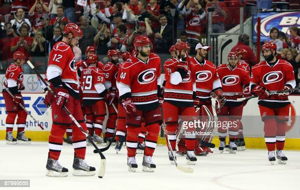 The Carolina Hurricanes look on after losing Game Four of the Eastern Conference Championship Round of the 2009 Stanley Cup Playoffs to the...