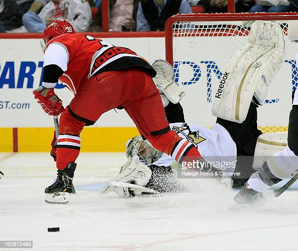 The Carolina Hurricanes' Patrick Dwyer left can't score against Pittsburgh Penguins goalie MarcAndre Fleury during the first period at the PNC Arena...