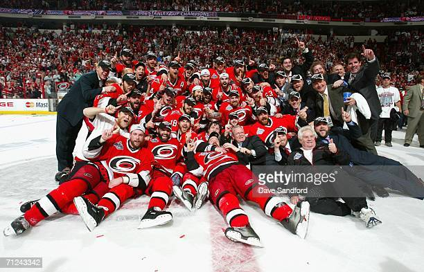 The Carolina Hurricanes pose together in celebration with the Stanley Cup after defeating the Edmonton Oilers in game seven of the 2006 NHL Stanley...