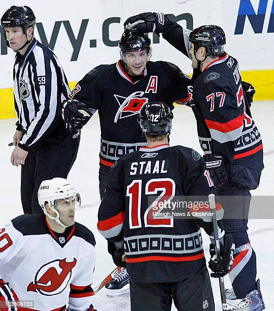 The Carolina Hurricanes' Ray Whitney celebrates his second goal of the game with teammates Eric Staal and Joe Corvo during second-period NHL action...