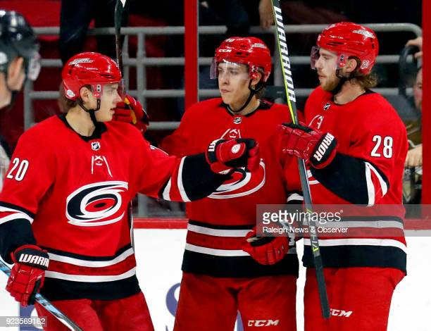 The Carolina Hurricanes' Teuvo Teravainen celebrates his goal with Sebastian Aho and Elias Lindholm during the second period against the Pittsburgh...