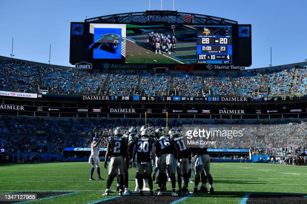 The Carolina Panthers huddle up during the fourth quarter against the Minnesota Vikings at Bank of America Stadium on October 17, 2021 in Charlotte,...