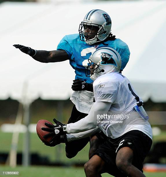 The Carolina Panthers' Wallace Wright hauls in a pass past Sherrod Martin during training camp at Wofford College in Spartanburg South Carolina...