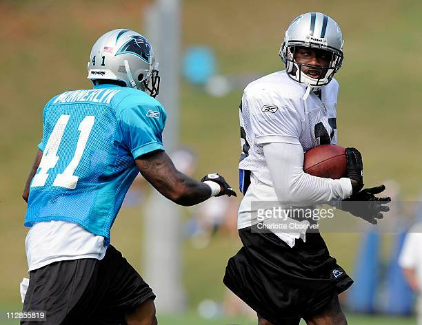 The Carolina Panthers' Wallace Wright looks over at Captain Munnerlyn as he runs following a long reception during training camp at Wofford College...