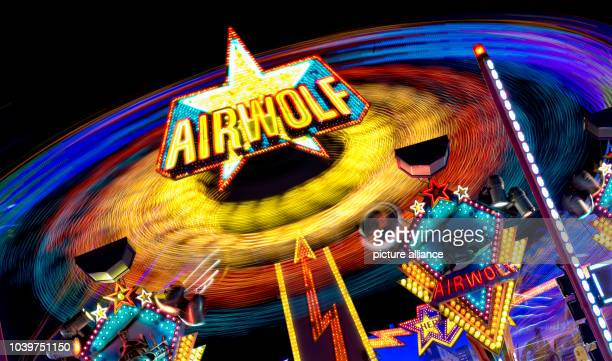 The carousel 'Airwolf' is pictured at funfair 'Dom' in Hamburg Germany 14 August 2013 The Sommerdom 2013 is open until 18 August 2013 Photo SVEN...