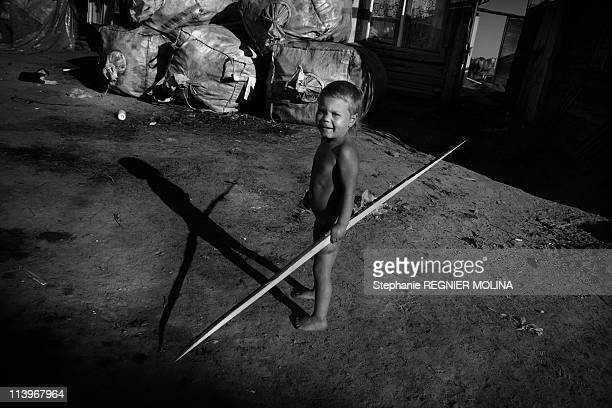 The Carpate Soul Daily Life Of A Gipsy Family In The Carpate Area In Miercurea Ciuc Romania On August 01 2009Young Romanian Roma child in front of...