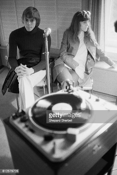 The Carpenters listen to a recording of 'Superstar' being broadcast on a Paris radio station