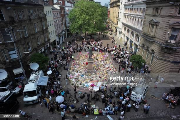 The carpet of floral tributes to the victims and injured of the Manchester Arena bombing covers the ground in St Ann's Square on May 25, 2017 in...