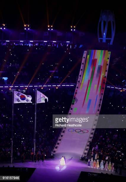 The carriers of the torch make their way to the cauldron during the Opening Ceremony of the PyeongChang 2018 Winter Olympic Games at PyeongChang...