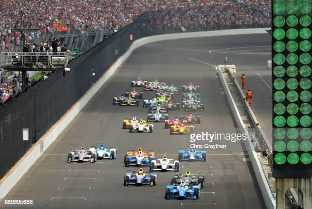 The cars coross the line for the start of the 101st running of the Indianapolis 500 at Indianapolis Motorspeedway on May 28 2017 in Indianapolis...