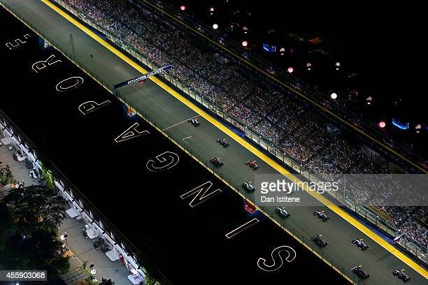 The cars excluding Nico Rosberg of Germany and Mercedes GP line up on the grid after the formation lap for the start of the Singapore Formula One...