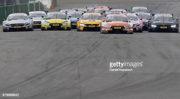 The cars heading for the first turn after a restart during race 2 of the DTM German Touring Car Hockenheim at Hockenheimring on May 7 2017 in...