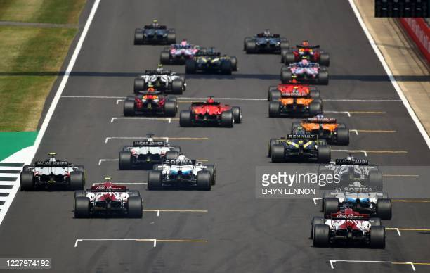 The cars leave the starting grid at the beginning of the race during the F1 70th Anniversary Grand Prix at Silverstone on August 9, 2020 in...