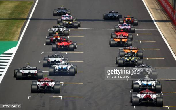 The cars leave the starting grid at the beginning the race during the F1 70th Anniversary Grand Prix at Silverstone on August 9, 2020 in Northampton....