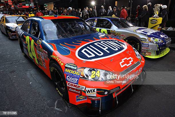 The cars of Jeff Gordon , driver of the DuPont Chevrolet, and Jimmie Johnson, driver of the Lowe's Chevrolet, wait on the street in Time Square prior...