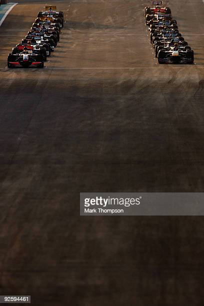 The cars prepare to start their warm up lap before the first Abu Dhabi Formula One Grand Prix at the Yas Marina Circuit on November 1, 2009 in Abu...