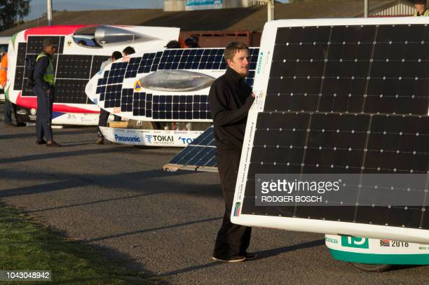 The car's solar panels are set up to face the sun before the start of the 8th and the final day of the Sasol Solar Challenge on September 29 in...