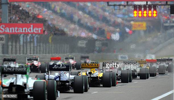 The cars start from the grid during Formula One's Chinese Grand Prix in Shanghai on April 18 2010 Defending champion Jenson Button delivered a...