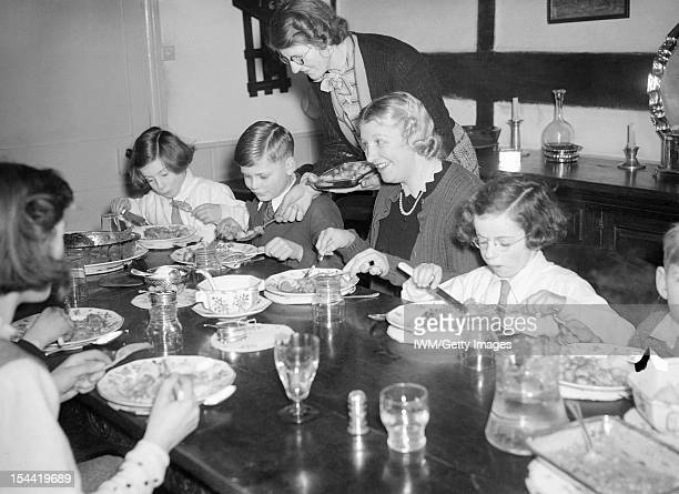 Everyday Life For A British Family On The Home Front England C 1940 Mrs Carter enjoys a Sunday lunch with her evacuated children Michael and Angela...