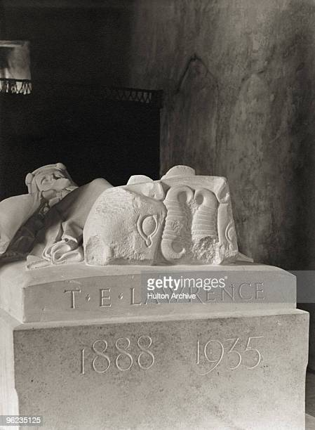 The carved inscription on a stone effigy by war artist Eric Kennington of British soldier adventurer and author T E Lawrence in the church of St...
