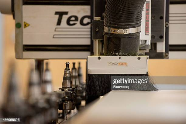 The Casa Kids logo is displayed on the head of a CNC router a computer controlled cutting machine at company's Red Hook facility in the Brooklyn...