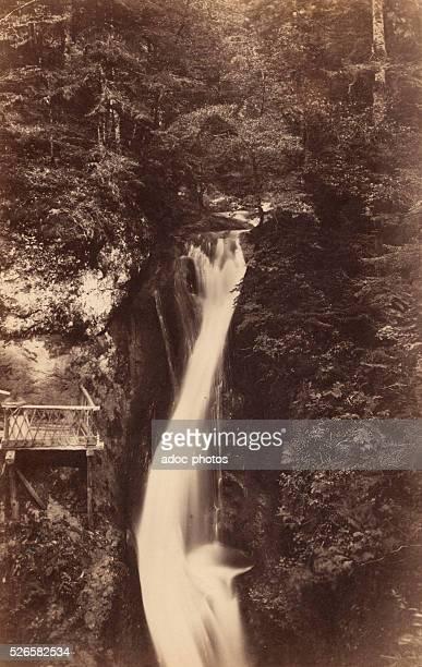 "The cascade of ""Le Plat �� Barbe"" near La Bourboule . Ca. 1870."