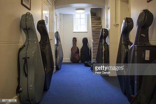 The cases of musical instruments left in a hallway at the Harrow School music centre Harrow School is an English independent school for boys situated...