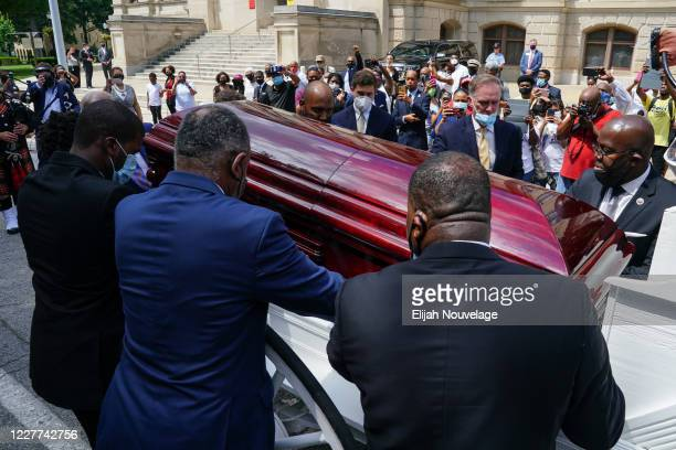 The casket bearing the remains of Civil Rights leader C.T. Vivian is placed on a horse-drawn carriage outside the Georgia Capitol building on July...