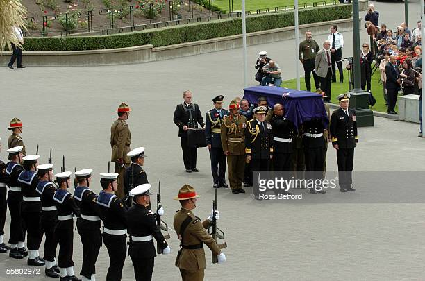 The casket bearing the unknown soldier passes a Guard of Honour on the forecourt of Parliament New Zealand Tuesday November 11 2004 The soldier will...