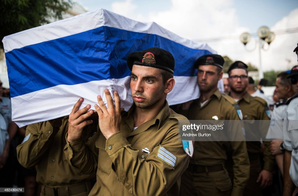 The casket carrying Israeli Sergeant Adar Barsano is carried to a burial plot in a cemetary during his funeral on July 20, 2014 in Nahariya, Israel. Sergeant Barsano was killed along with another IDF soldier on the twelfth day of operation 'Protective Edge,' when Hamas militants infiltrated Israel from a tunnel dug from Gaza and engaged Israeli soldiers.