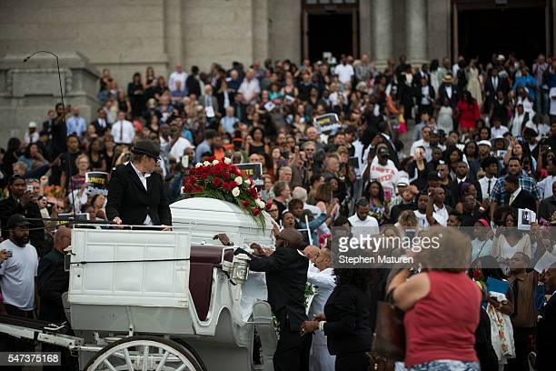 The casket carrying Philando Castile is loaded into a horse drawn carriage at the Cathedral of St Paul on July 14 2016 in St Paul Minnesota Castile...