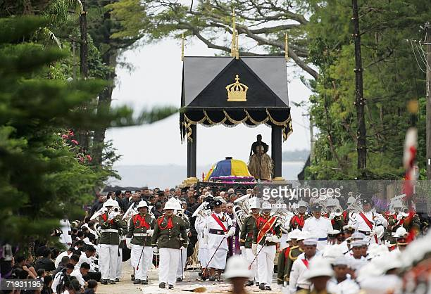 The casket carrying The Late King Taufa'ahau Tupou IV proceeds down the road toward the burial site during the State Funeral for King Taufa'ahau...