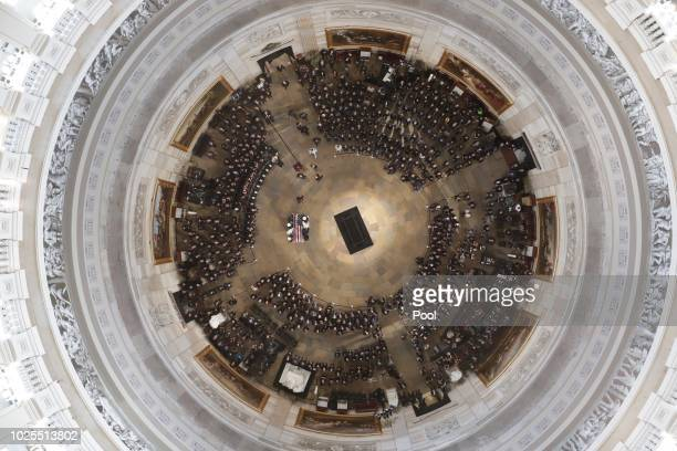 The casket carrying the late U.S. Sen. John McCain, R-Ariz., is carried into the U.S. Capitol Rotunda on August 31 in Washington, DC. The late...