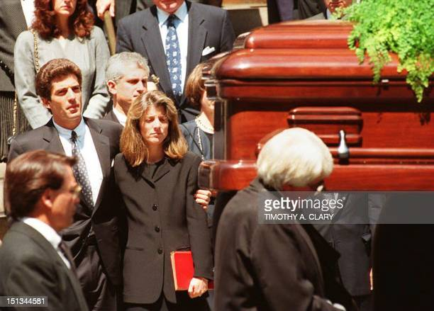 The casket containing the body of Jacqueline Kennedy Onassis is carried from St Ignatius Loyola Roman Catholic Church in New York City 23 May 1994 To...
