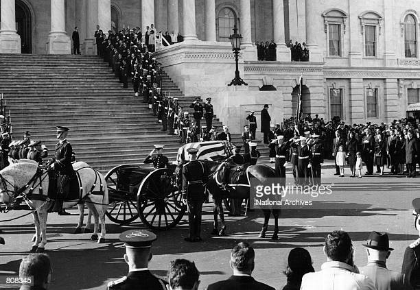 The casket containing the body of John F. Kennedy arrives for a ceremony at the U.S. Capitol Building November 24, 1963.