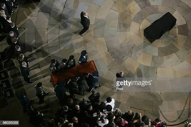 The casket containing the body of Rosa Parks is carried into the Capitol Rotunda to lie in honor at the October 30 2005 in Washington DC Parks is the...