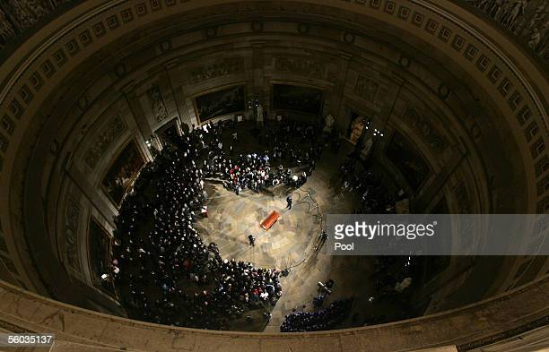 The casket containing the body of Rosa Parks lies in honor at the Capitol Rotunda October 30 2005 in Washington DC Parks is the first woman and the...