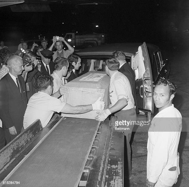 The casket containing the body of singer-actress Judy Garland is placed into a hearse at airport here early June 26th after arrival from London....