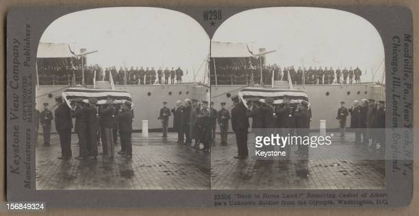 The casket containing the body of the American World War I Unknown soldier arrives at the Washington Navy Yard Washington DC on board the USS Olympia...