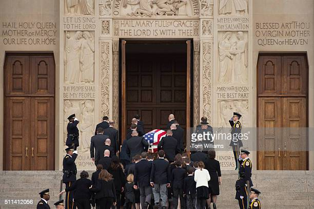The casket containing the body of the late Supreme Court Justice Antonin Scalia is carried into the Basilica of the National Shrine of the Immaculate...