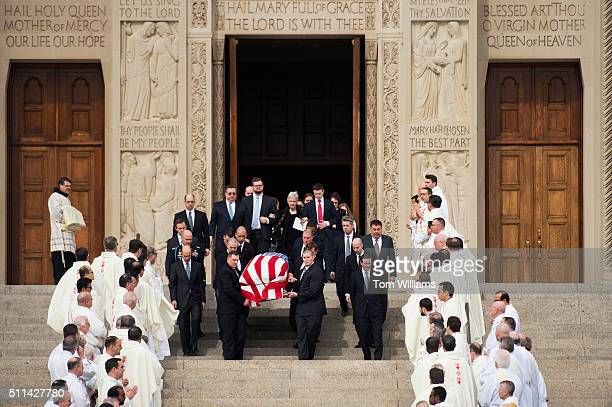 The casket containing the body of the late Supreme Court Justice Antonin Scalia is carried out of the Basilica of the National Shrine of the...