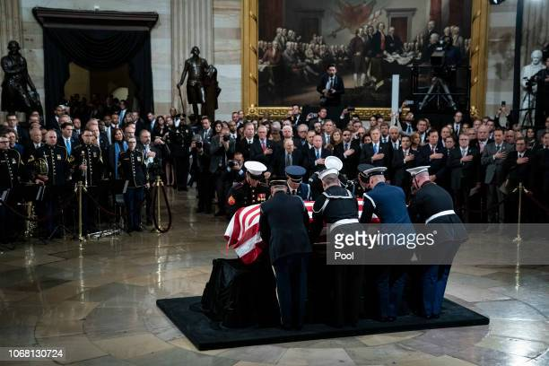 The casket containing the remains of former US President George HW Bush is carried in by military honor guard to the US Capitol Rotunda to lie in...