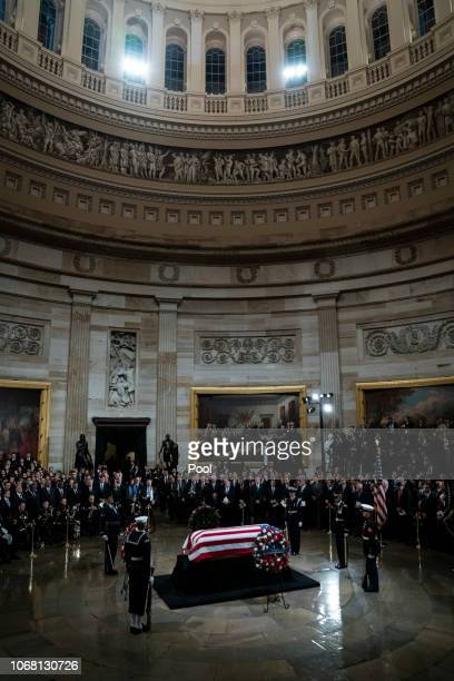 The casket containing the remains of former US President George HW Bush lies in state at the US Capitol Rotunda on December 03 2018 in Washington DC...