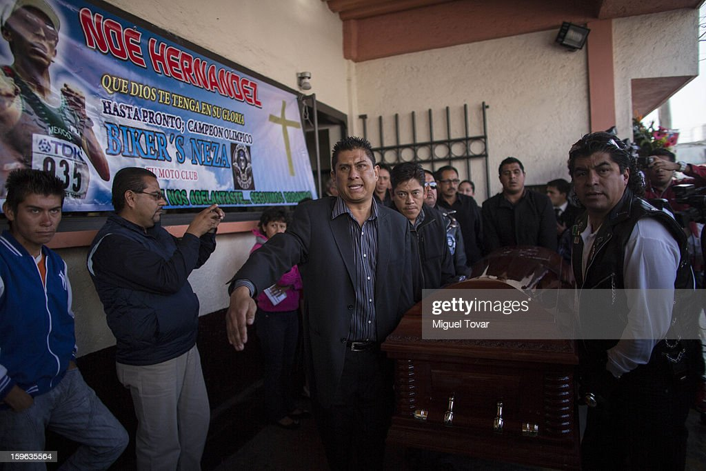 The casket containing the remains of mexican Mexican athleteNoe Hernandez is carried outside the funeral parlor on January 17, 2013. Hernandez died yesterday of a heart attack after recovering from a shot in the head received last December 30 near his house at the outskirts of Mexico City, Mexico.