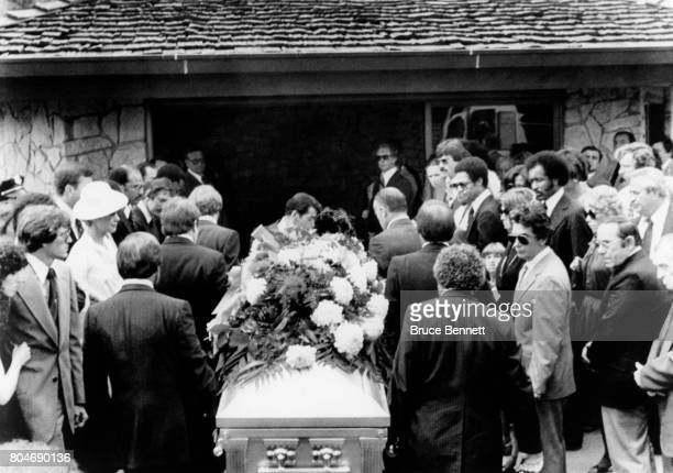The casket containing the remains of New York Yankees catcher Thurman Munson, is carried in front of ballplayers and friends, to the chapel at the...